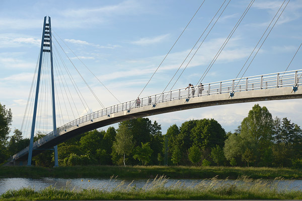 cable-stayed foot bridge with gorgeous sky and river view