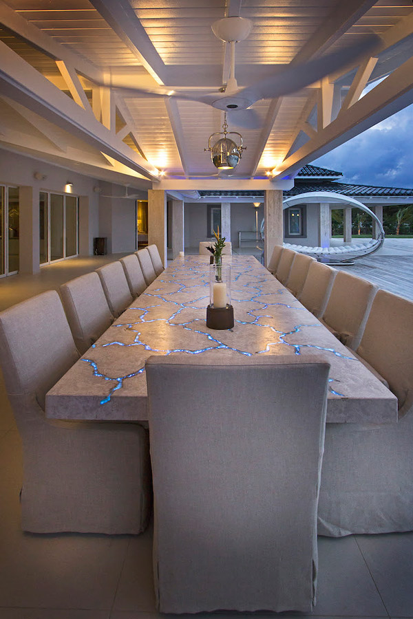 "concrete table with fiber optics - An ""outrageous"" beach house on the French side of the Caribbean island St. Martin needed an anything-but-usual outdoor table."