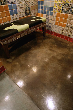dark brown floor with tiled wall