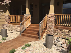brown concrete entryway and stairs