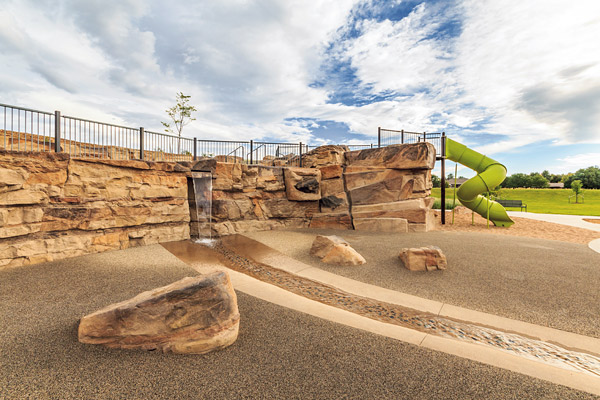 "Whereas the original design called for a 14-foot wall of stacked sandstone, the city park in Denver ended up with GFRC rock panels that better mimicked the desired Colorado terrain. The judges called the coloring ""astonishing."""