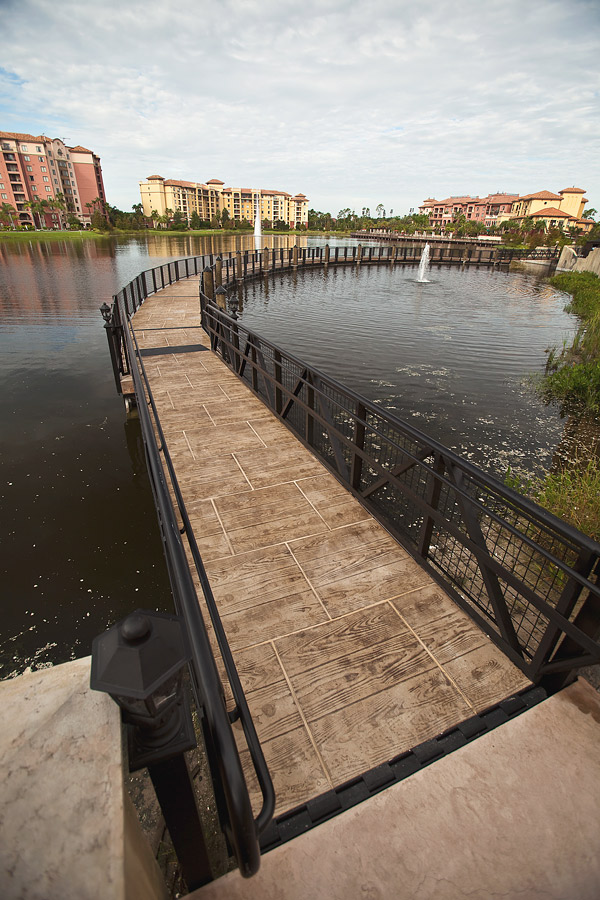 stamped concrete walkway bridge over water