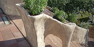 Waving carved concrete handrails that look similar to bone.