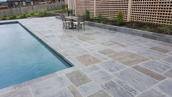 slate pool deck with natural looking architectural concrete