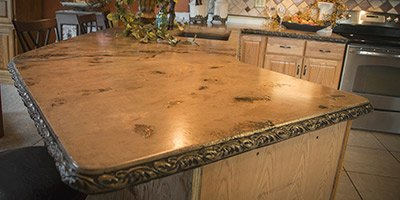 Using products purchased through StoneCrete's Ashby System, Excalibur delivered 52 square feet and 1,660 pounds of beautiful 2-inch-thick countertops in three sections that look as if they were hewn from a cliff.