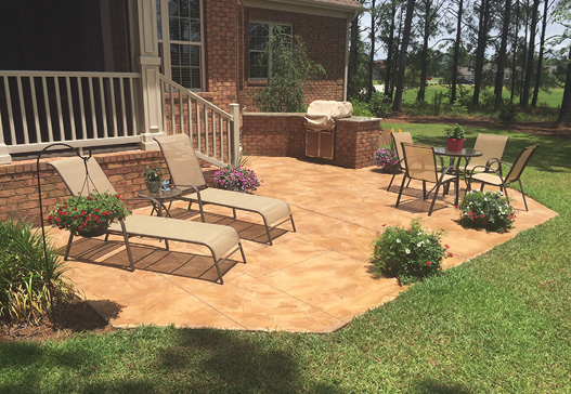 Inviting stamped concrete patio with furniture