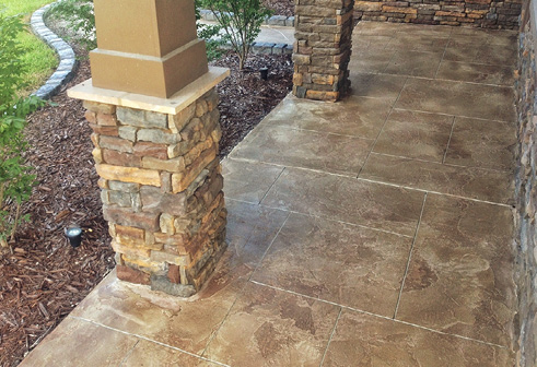 Rustic hues on a stamped concrete covered walkway.