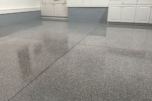 Epoxy chip garage floor coating gives a clean look to the space.