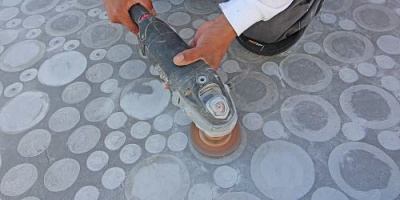using various sized grinder attachments and following a mapped out custom design, each bubble was created by hand. Similar results could have been obtained with stencils or tape,