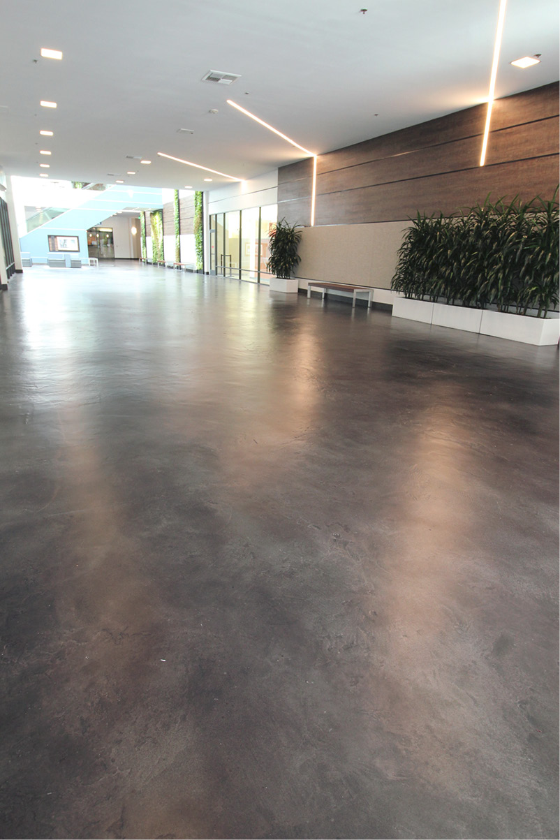 grey concrete floor in front of shopping center
