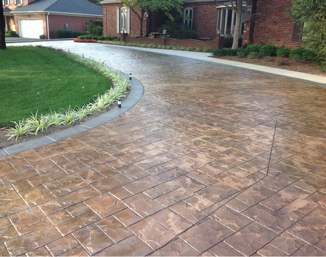 stamped concrete driveway with grass around