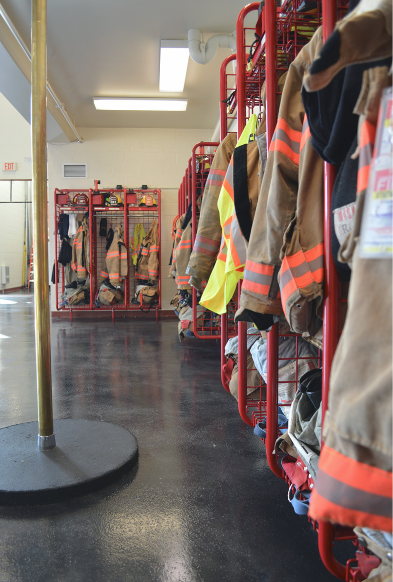 firefighter uniforms and grey floor