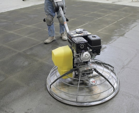 power trowel on wet concrete
