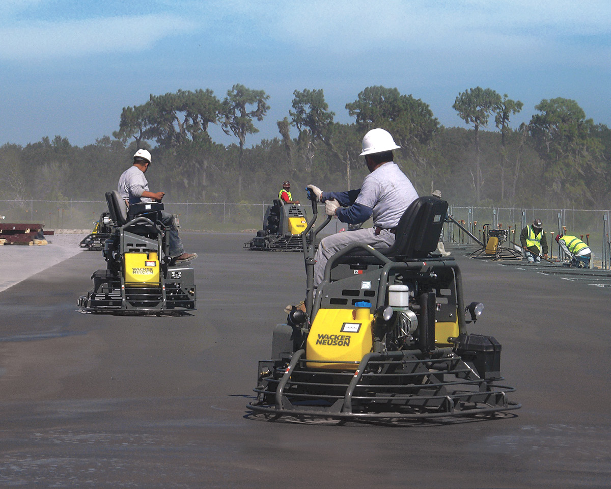 men on ride on units to complete a job