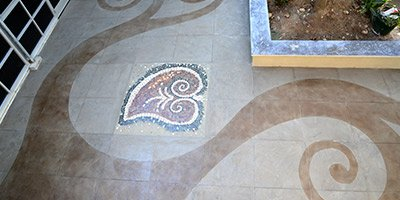 heart lithomosiac on concrete floor with swirl design