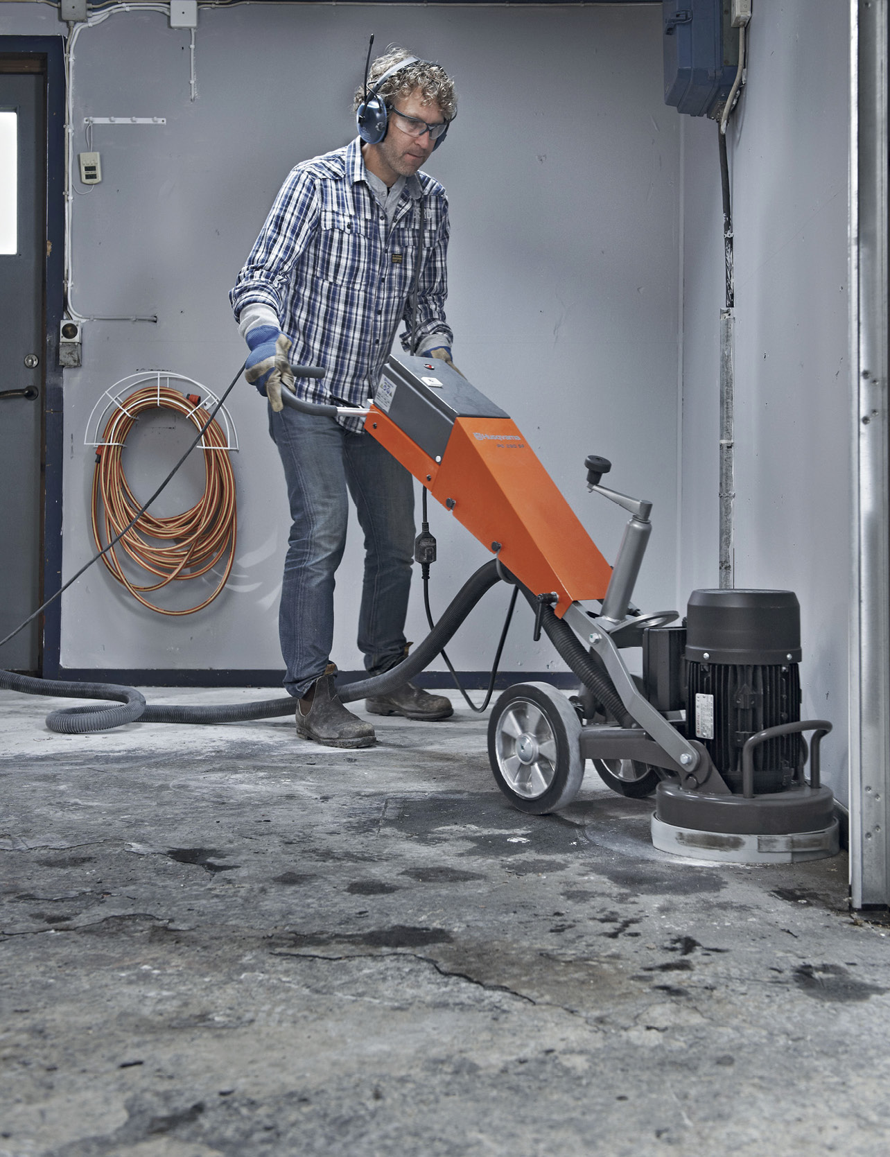 man polishing a concrete floor