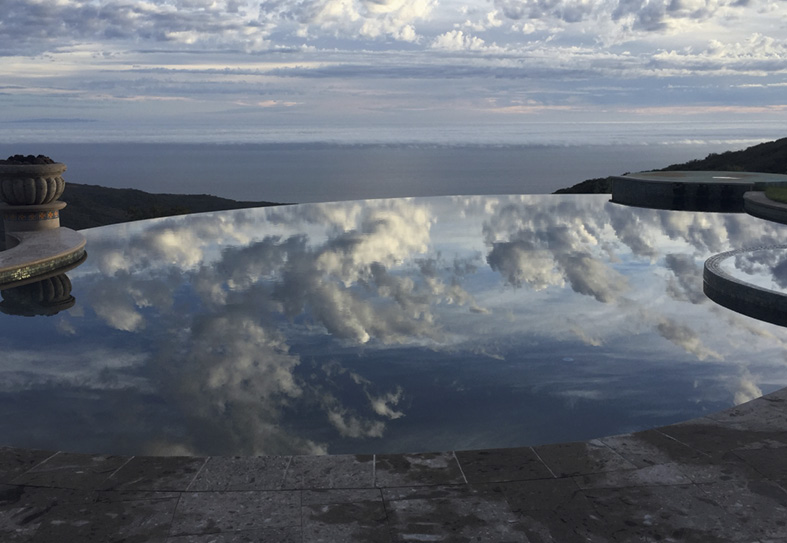 reflection of sky and clouds on swimming pool