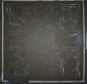 light colored chalk design on concrete