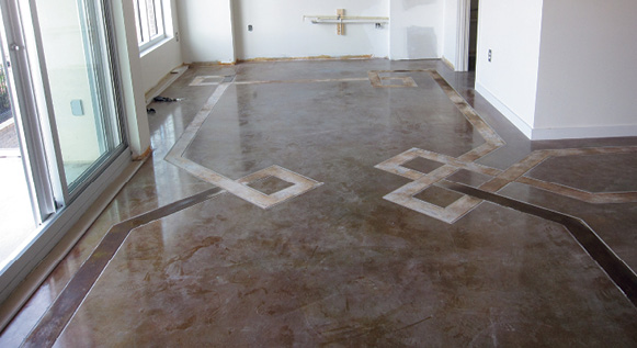 stained ribbon border on brown concrete floor