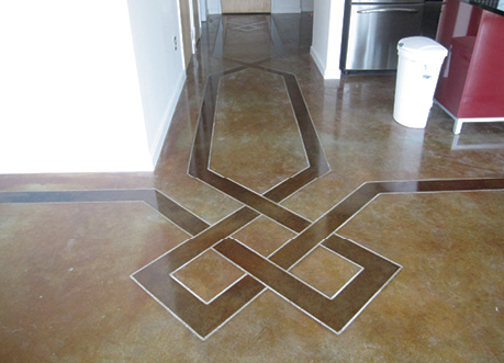 stained ribbon border on brown dyed concrete floor