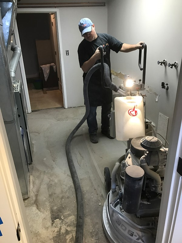 "Garry Henry uses the L30G-X -- a ""beast of a machine"" -- to grind a surface. (Photo courtesy of 2 Palms Decorative Concrete LLC.)"
