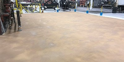 Concrete floor restoration in Nebraska's Timpte Manufacturing Plant filled in gouges, holes and cracks in the concrete.