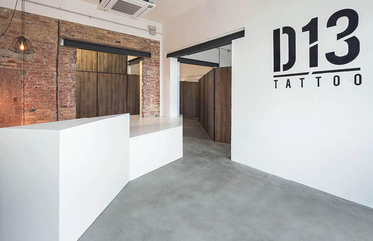 Tattoo parlor uses concrete as it's countertop material. White countertop in D13 Tattoo.