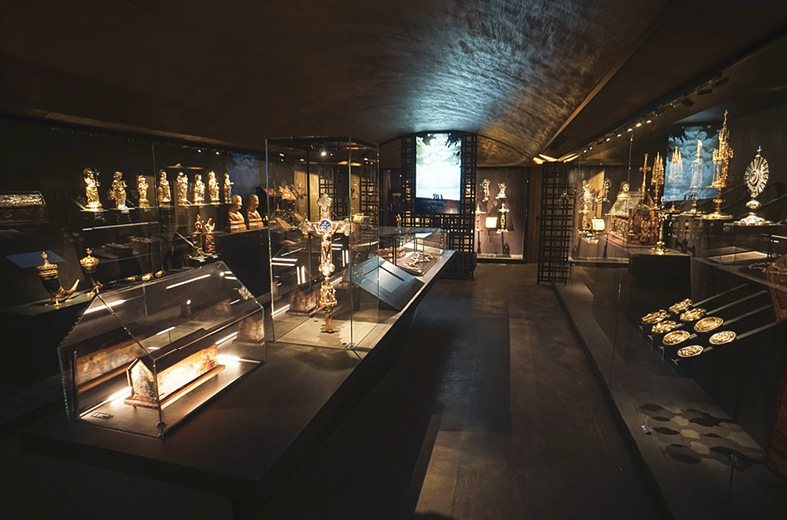 Stained Concrete floors and dark brown concrete countertops in a gold statuary store in Italy.