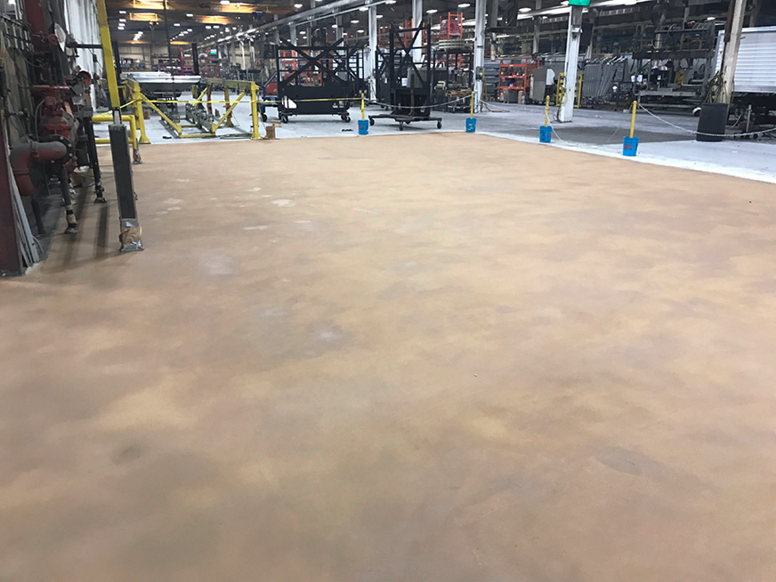 timpte manufacturing plant had ground-in dirt and oils that added to the toxic mix that needed to be repaired with decorative concrete overlay.