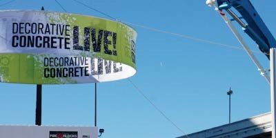 Circular banner with Decorative Concrete Live logo hanging at the World of Concrete.