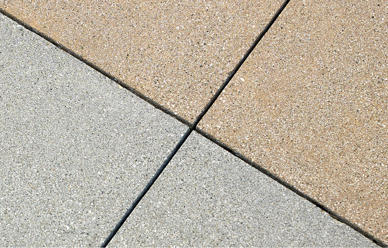 Top Surface retarder creates a consistent sand finish in two adjacent colored concrete lacements separated by saw cuts. Photo courtesy of Trademark Concrete Systems Inc.