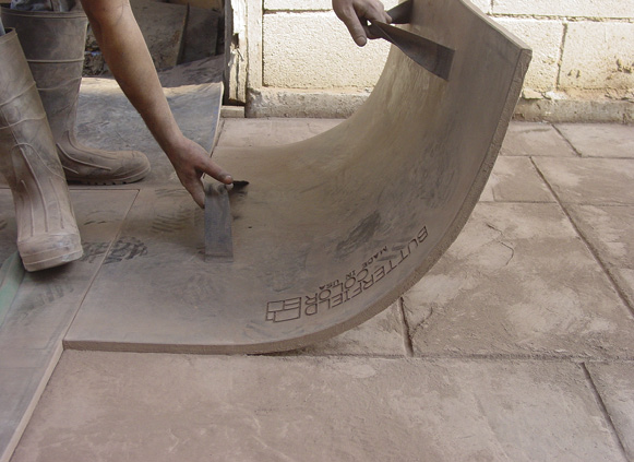 A patterned mat requires a bit more finesse when picking it up and repositioning. Although possible contact with wet concrete is limited at this stage, Concrete Decor recommends gloves be worn at all times when texturing concrete. Photo courtesy of Butterfield Color