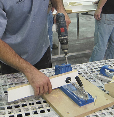 To use the pocket-hole technique, you first use a jig to drill the pocket-screw hole, as shown in this photo:
