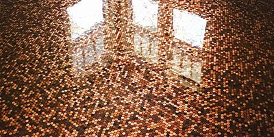 A floor covered in pennies and then sealed with epoxy.