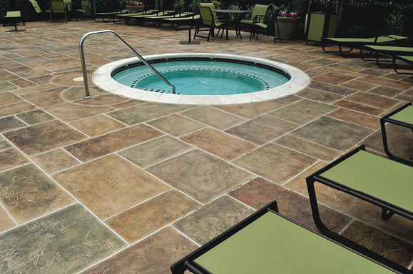 For a realistic look, this contractor goes back after the concrete has been stamped and brushes on a special type of grout and then by hand stains the stone and in between the stones.