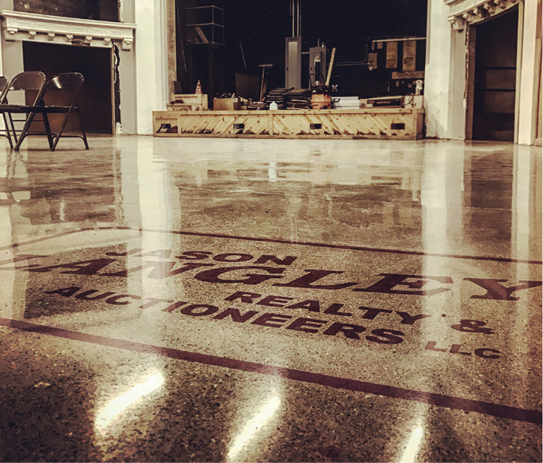 Jason Langley Realty & Auctioneers logo on a glossy polished concrete floor in a historical building in Washington Court House, Ohio.
