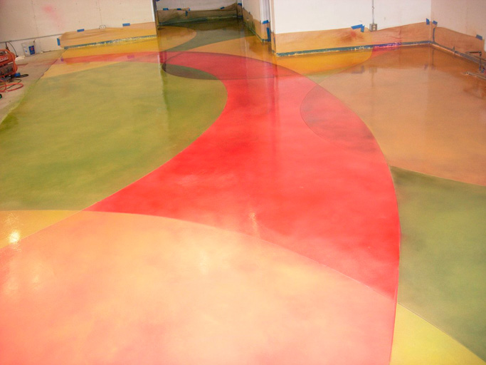 To get these bright colors, this floor was micro-topped with a white mix and colored with water-based stains from the SS Rainbow collection that were feathered together with a high-volume low-pressure sprayer. SS Poly Pro 38 — a high-solid, two-part sealer — was then applied to add shine and durability. Photo courtesy of iCoat Photo courtesy of The Stamp Store