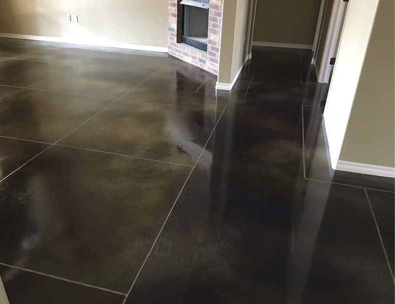 Contractor Rick Ogden acid stained this residential floor a diluted black and then had problems with residues and extreme finish measures. His solution was to use an acetone dye in a corresponding color since the floor was already profiled and readily accepted the dye.