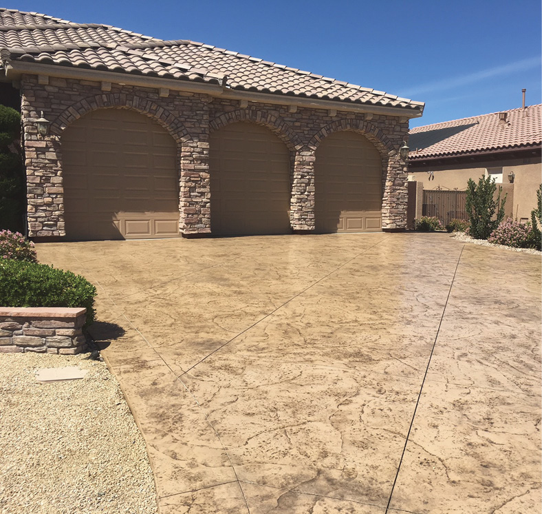 After installing Westcoat's TC-6 overlay tinted with Sahara stain and antiqued with a Mocha-colored release, contractor Mike McAnulty stamped this driveway with an Old Granite pattern from Proline. It was then sealed with Arizona Polymer's Poly 250.