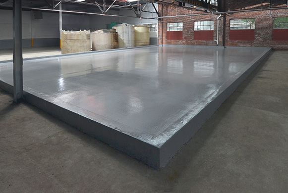 One coat of Drytek's two-part epoxy coating can effectively control the moisture vapor emission rate from new or existing concrete slabs.