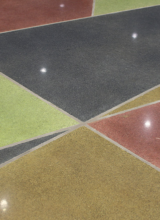 Terrazzo floor system with tight angles.