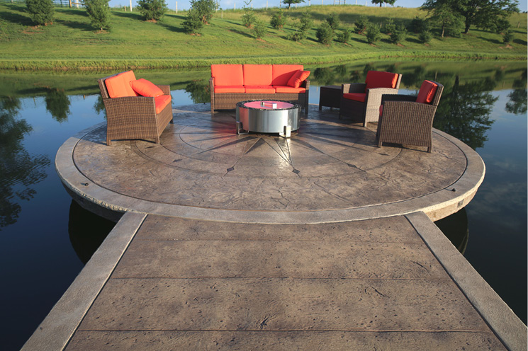 The pier leading to the dock features a pattern formed with Proline's Reclaimed Timber stamps and Brownstone color hardener and Chocolate release, flanked by 8-inch borders created with a Quarry Stone texture mat and colored with Travertine color hardener.