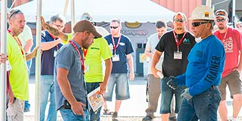 Decorative Concrete Trainer talking with an attendee at a trade show at Brickform last summer.