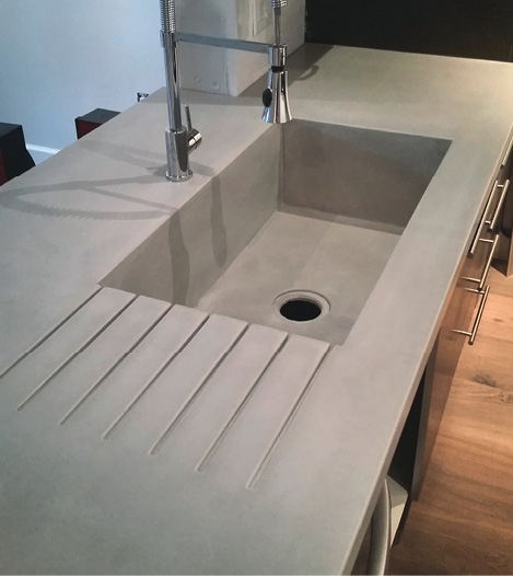 Seamless kitchen countertop with integral sink and drain board GFRC.