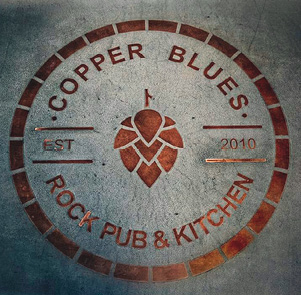 Copper Blues Rock Pub and Kitchen logo made of copper and concrete.