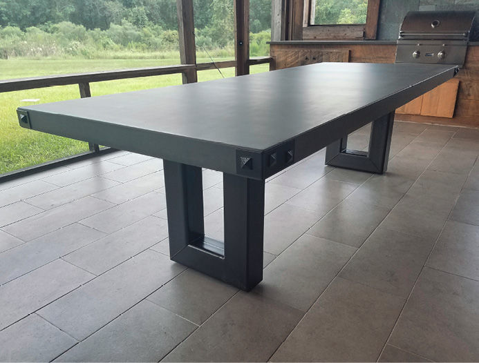 Large GFRC table for an outside kitchen with bolts on the corner.