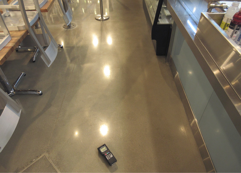 The clarity of reflections on a floor where the gloss is created by stain protection isn't very clear.