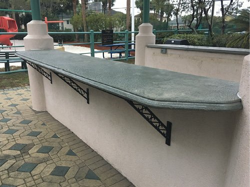 Unique teal green bar tops made of concrete for a clubhouse in Destin, Florida.Photos courtesy of Concrete In-Counters concrete countertop