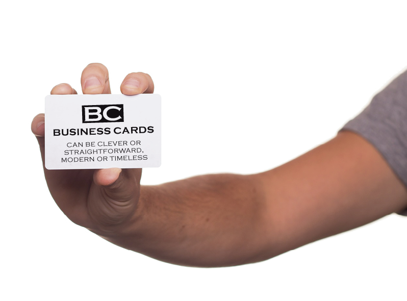"A hand holding a business card ""BC"" Business cards. Can be clever or straightforward modern or timeless."