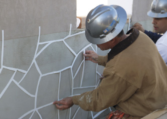 Stencil placement on a concrete wall system at Concrete Decor's Decorative Concrete Live at World of Concrete 2018.